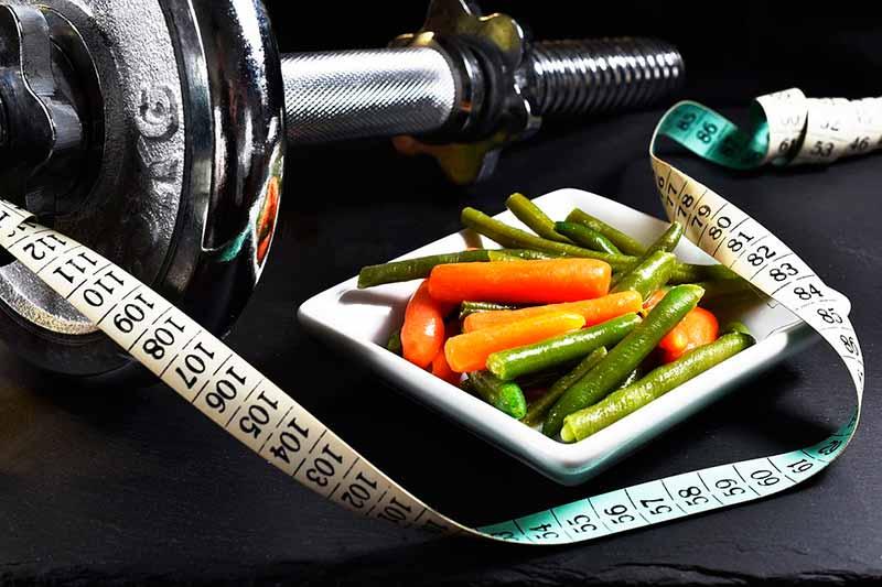 como-acelerar-el-metabolismo-pesas-comer-sano